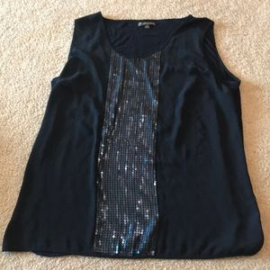 Blue sleeveless top with sequin patch in the front